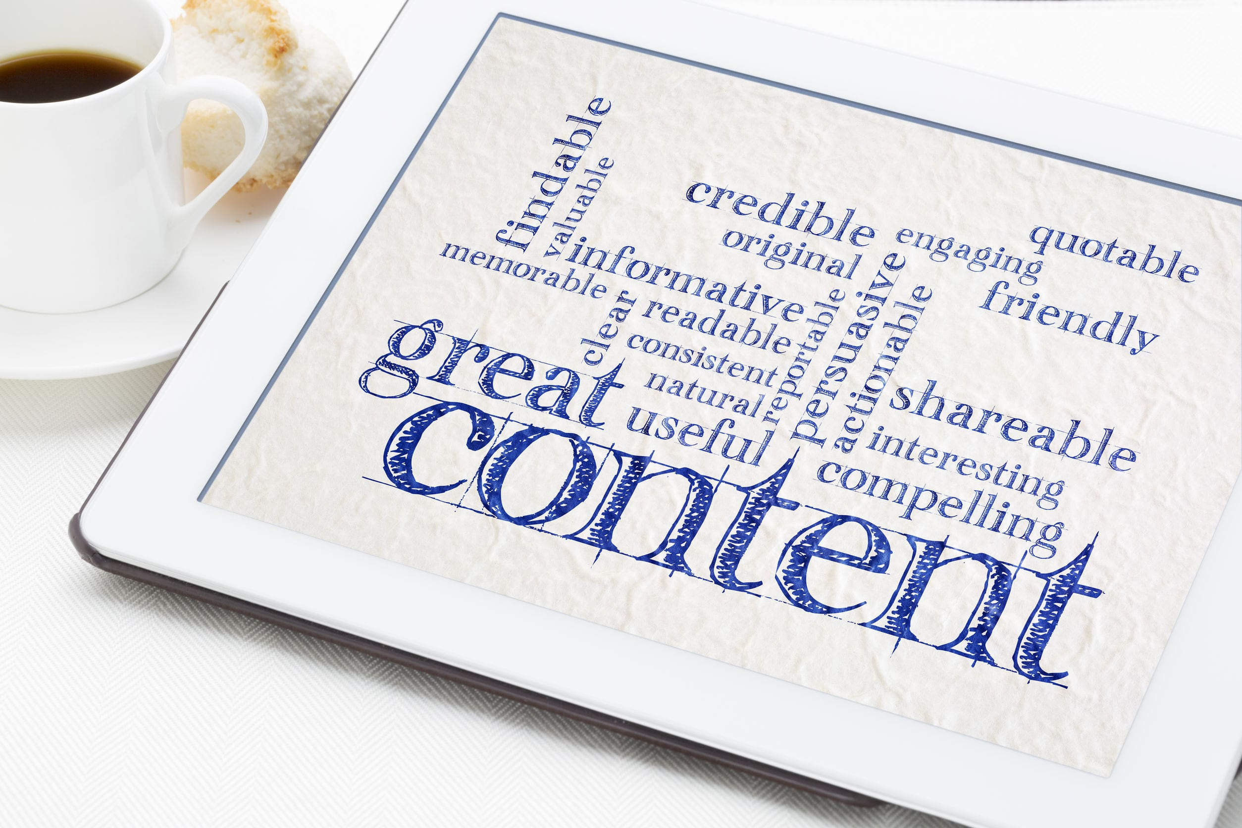 great content writing word cloud on a digital tbalet with a cup of coffee  -  business writing and content marketing concept